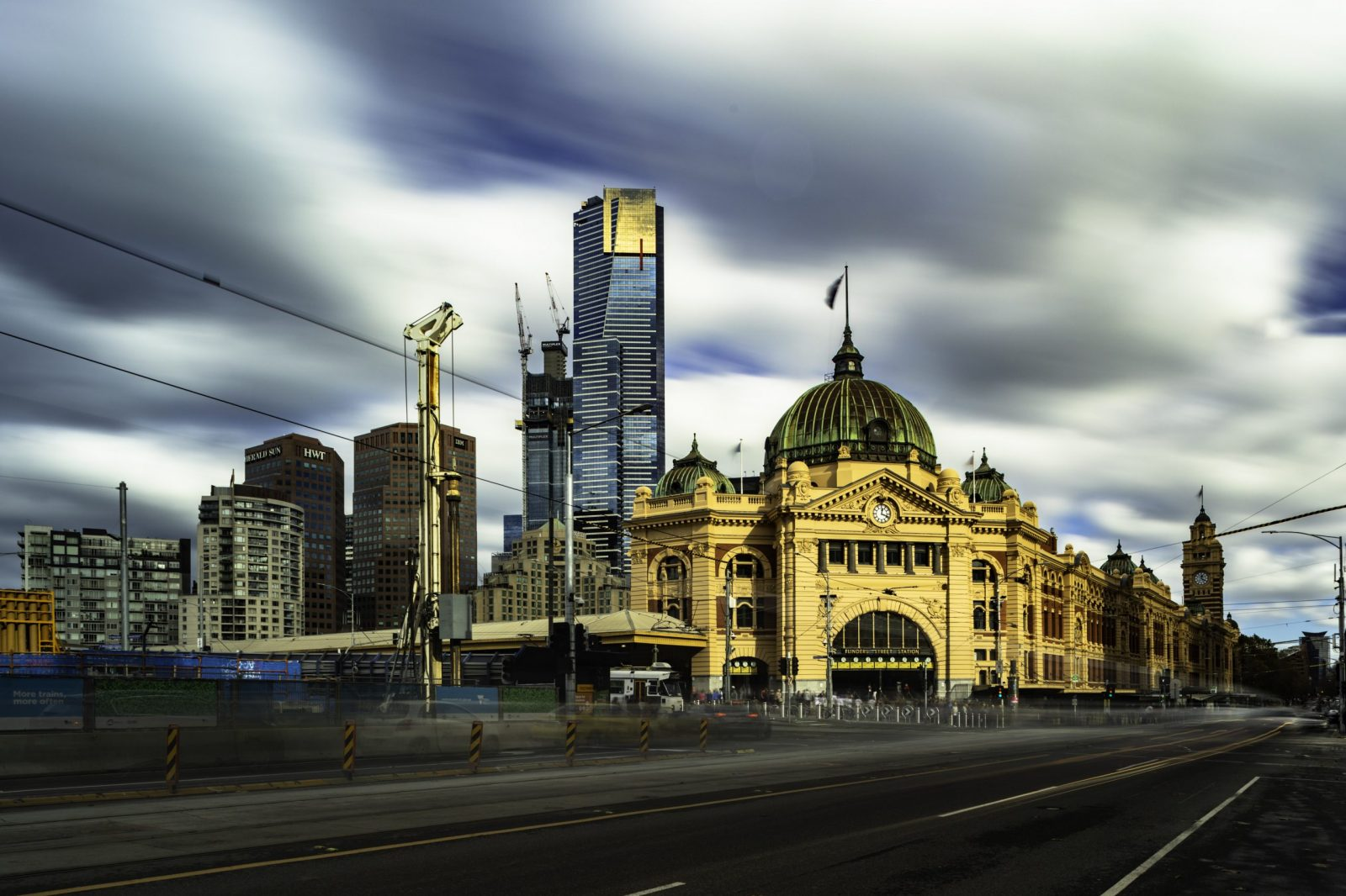 Flinders Station shot wide with 10 stop long exposure during the day.